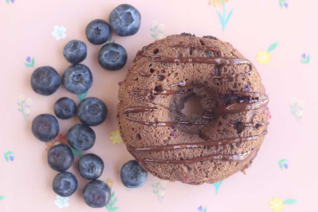 baked-chocolate-donut-with-blueberries-on-placemat