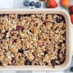 triple berry fruit crisp in baking pan