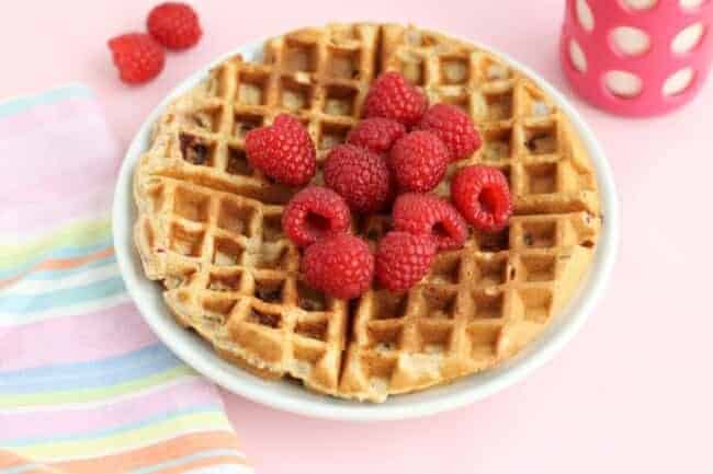 whole wheat waffles with raspberries