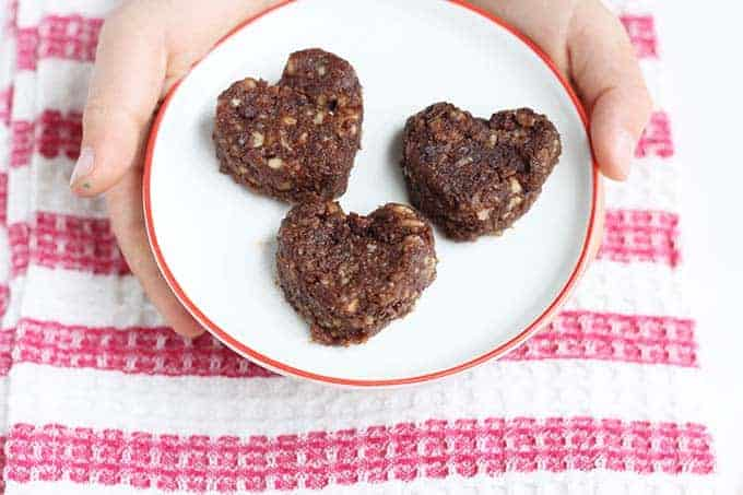 heart shaped cashew cookies on white plate