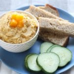butternut squash hummus on plate with cucumbers