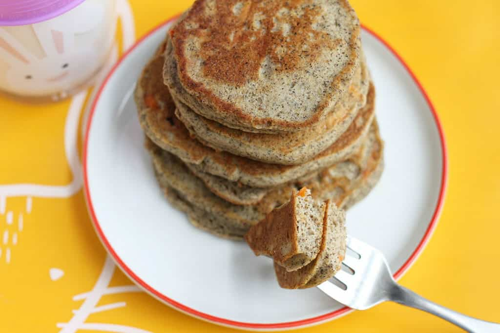 healthy pancakes with carrots and yogurt stack