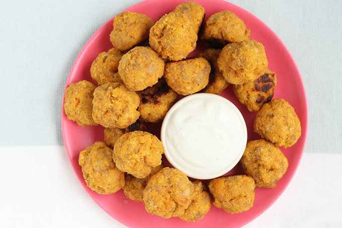 Chicken meatballs on plate with cheese sauce