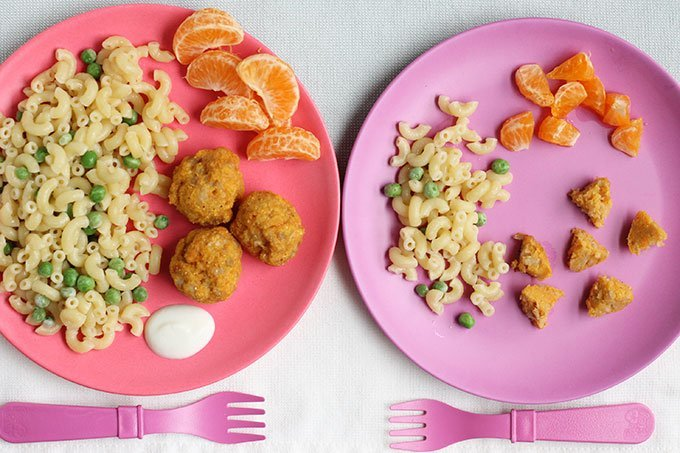 baked chicken meatballs on two kids plates