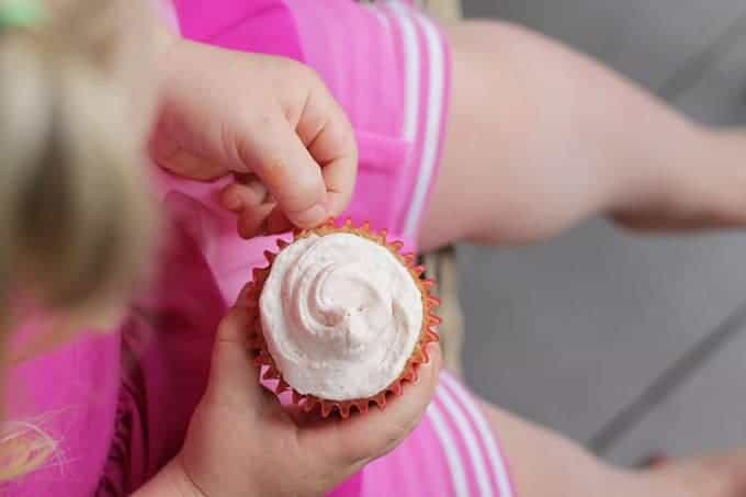 strawberry cupcakes with girl in pink clothes