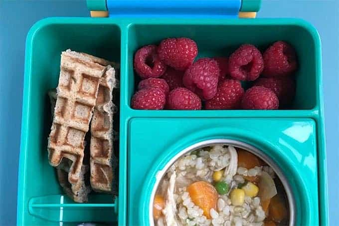 kids lunchbox with soup, waffles, and berries