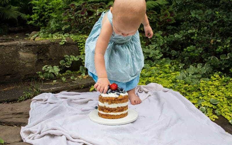 toddler girl with smash cake