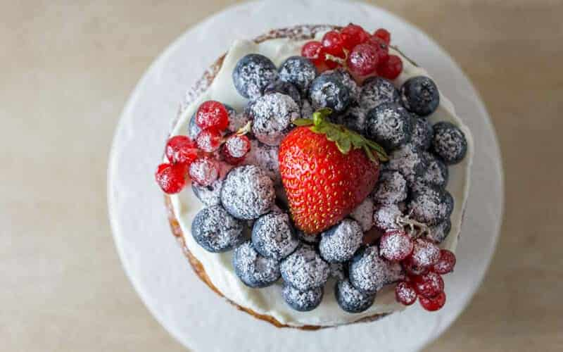 healthy first birthday cake with oats and berries on top