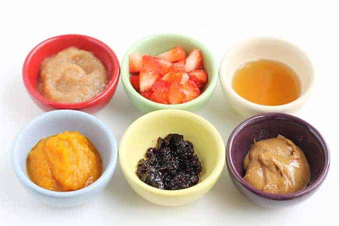 flavorings for baby yogurt including applesauce, berries, and nut butter