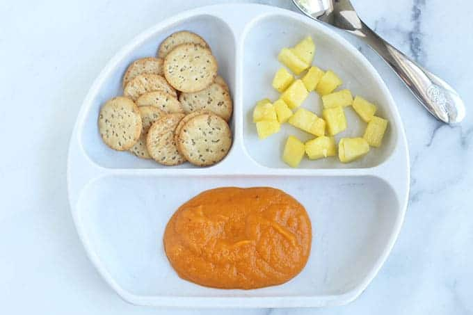vegan-tomato-soup-on-white-divided-plate
