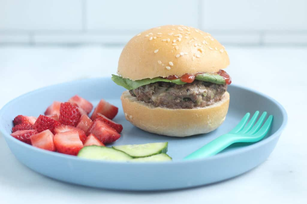 zucchini-burger-on-bun-on-blue-plate
