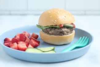 zucchini-burger-on-bun-on-blue-plate
