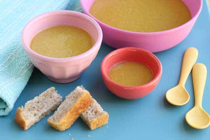 vegan butternut squash soup in three bowls with toast sticks