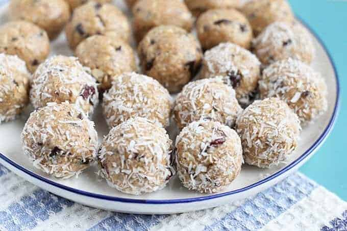 no bake peanut butter balls in coconut on white plate