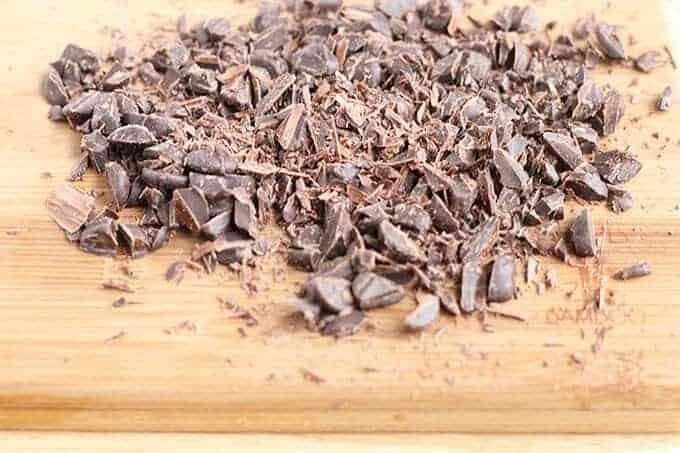 chopped chocolate on cutting board