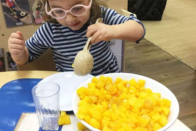 toddler-serving-herself-peaches