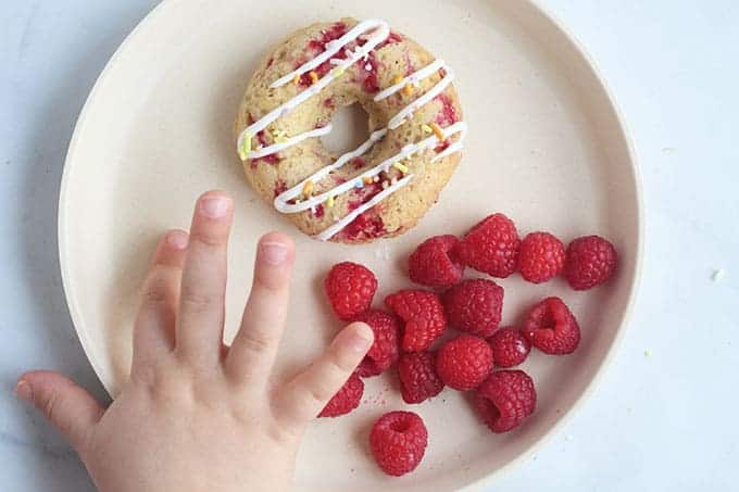 raspberry-donut-on-white-plate-with-berries