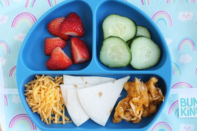 slow cooker chicken tacos on divided blue kids plate