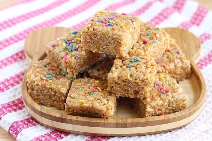 peanut butter rice krispie treats on wooden plate