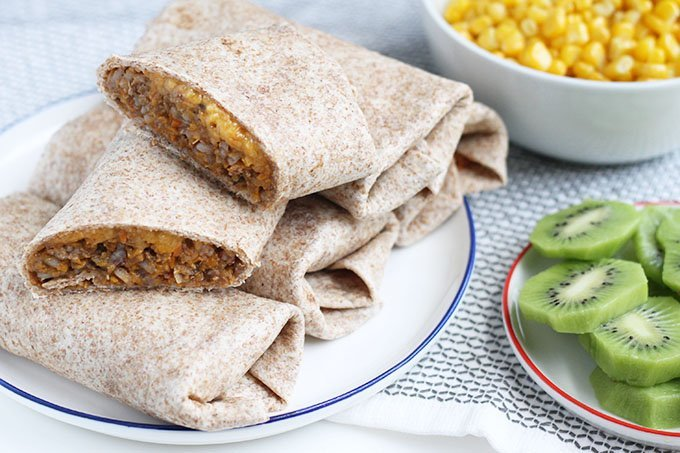 beef burritos on plate with sides