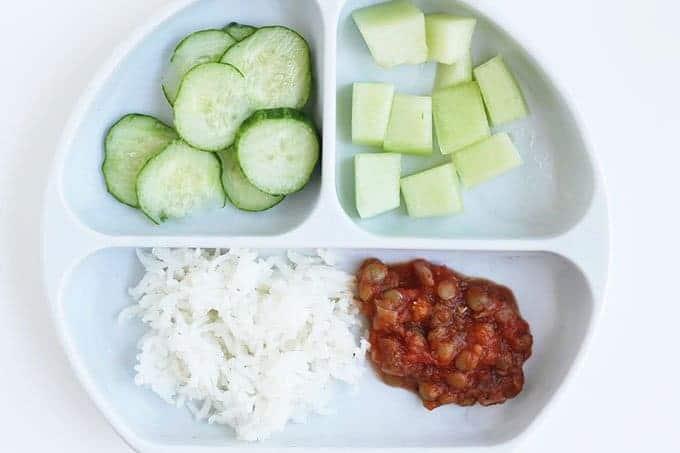 green lentils recipe on divided white plate