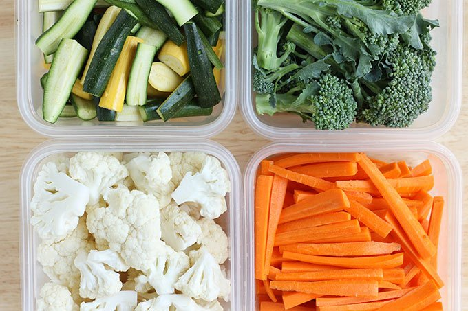 cut up vegetables in containers
