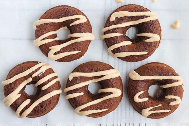 baked pumpkin donuts with frosting