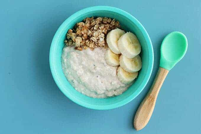 overnight oats for kids in a blue bowl with a bamboo spoon