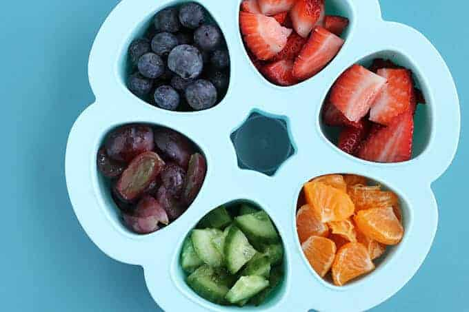 toddler breakfast idea precut fruit in blue storage container