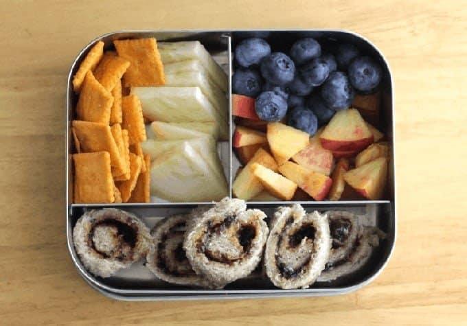 sunbutter spirals, crackers, fruit in stainless steel lunchbox