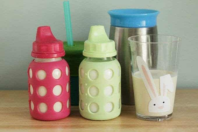 toddler sippy cups in glass and silicone, and open cup with bunny