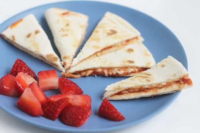 pizza quesadillas on blue plate with berries