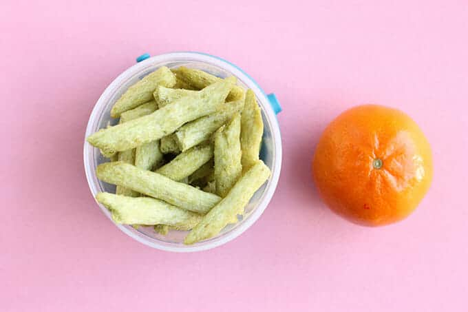 toddler snack of snap pea crisps and clementine