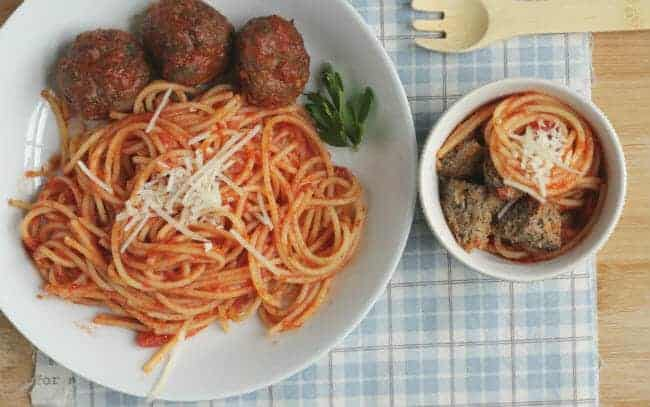 healthy meatballs with veggies overhead shot with adult portion and child portion