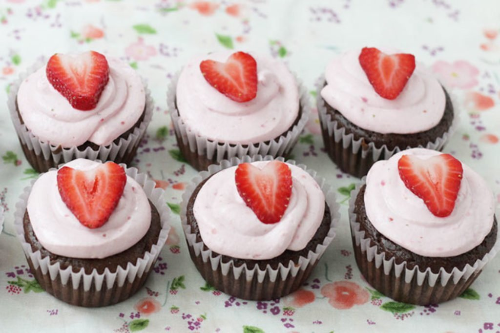 chocolate cupcakes in a row with strawberries