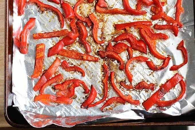 roasted red peppers on foil lined sheet pan