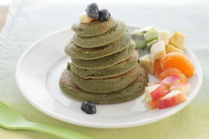 spinach banana pancake stack with fruit rainbow