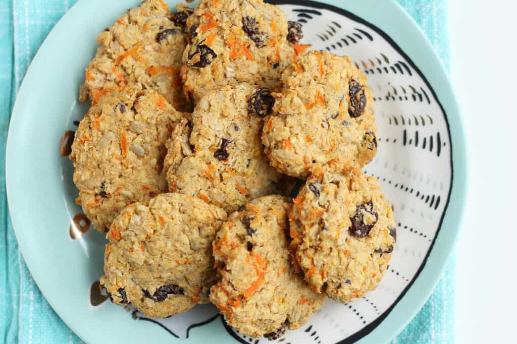 healthy Oatmeal cookies with apples and carrots on blue plate