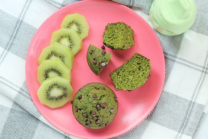 spinach muffins on a plate with fruit