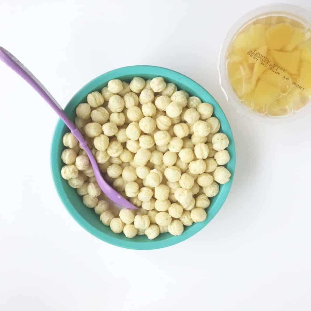 kix in teal kids bowl with canned fruit