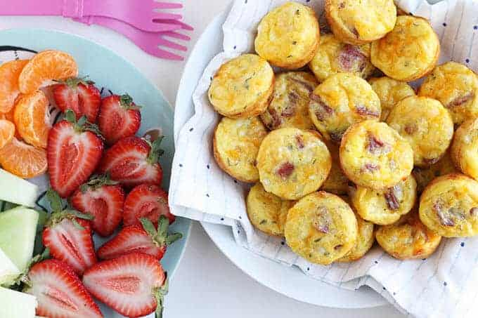 bacon egg and cheese cups in bowl with strawberries
