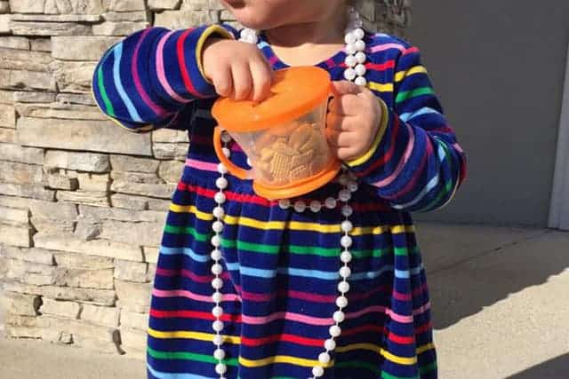 toddler with snack cup