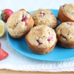 strawberry muffins on blue plate with berries and lemon