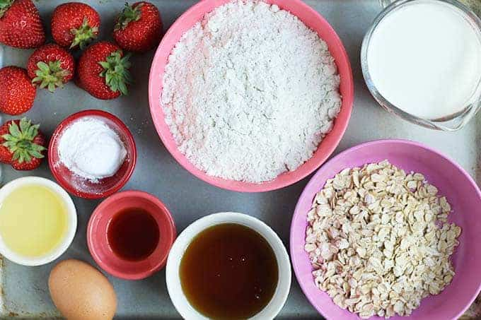 ingredients for strawberry muffins on a cookie sheet