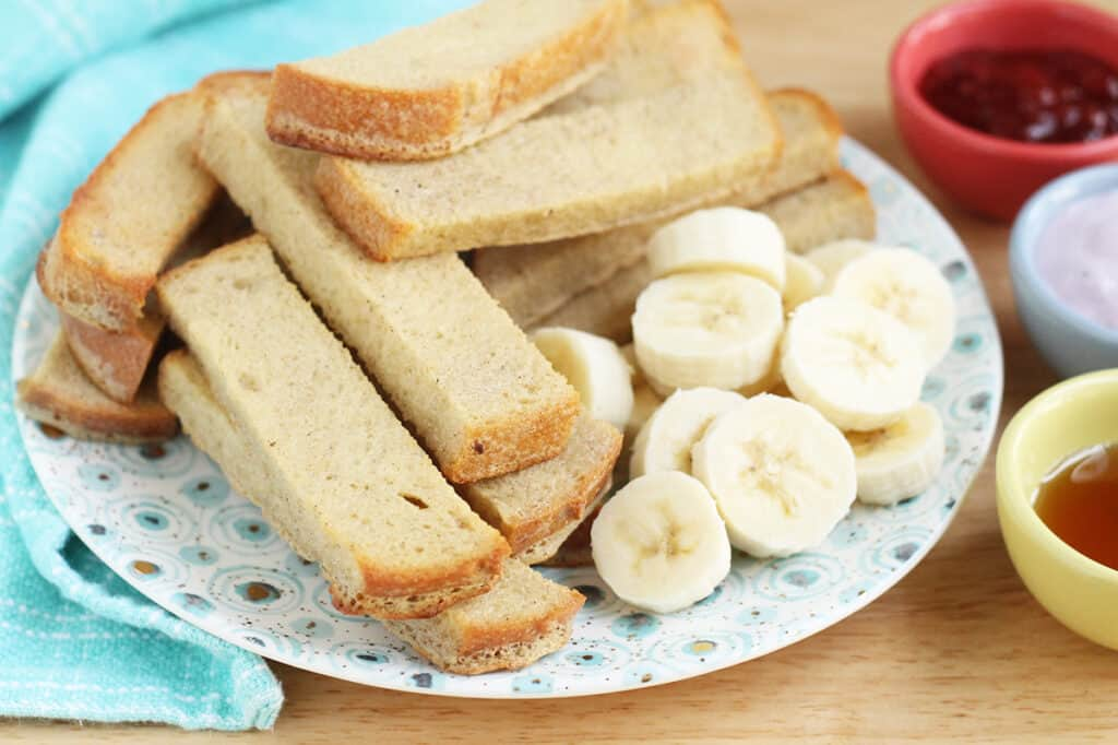 baked-french-toast-sticks-on-plate-with-bananas