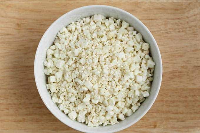 cauliflower crumbles in white bowl