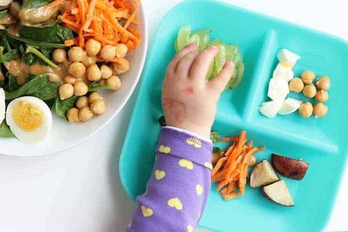kid friendly salad plate with hard cooked eggs, beans, potatoes, and carrots
