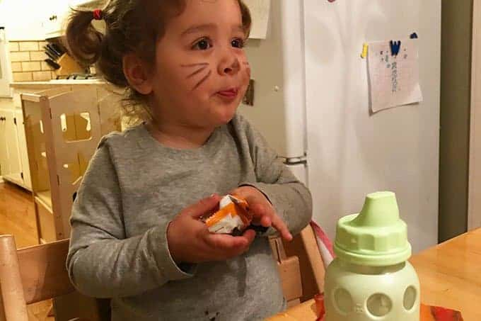 toddler eating halloween candy