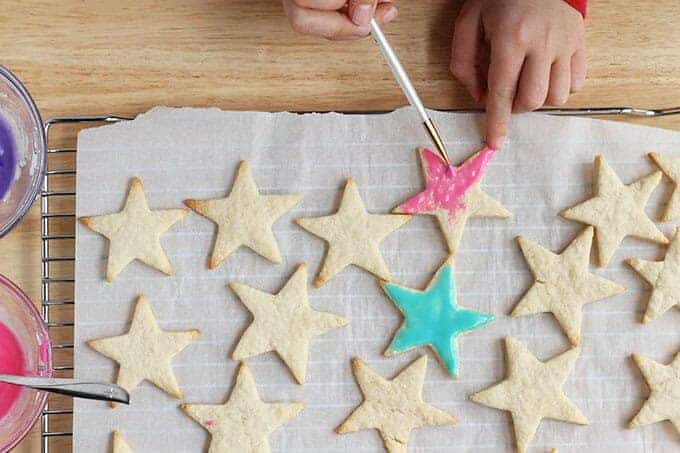 icing healthy sugar cookies with paintbrush