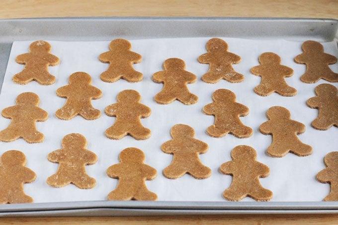 gingerbread cookies ready to bake on sheet pan